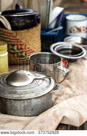 Group Of Rustic Cookware, Pots And Pans On A Table Outdoors At The Local Market Of Toliara, Madagasc
