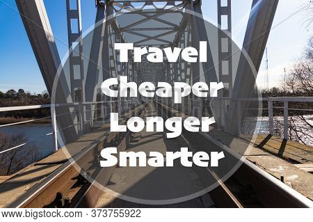 Travel Cheaper Longer Smarter - Inspirational Quote On The Background Of The Railway Bridge