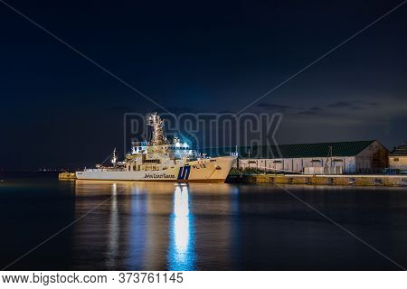 Otaru, Japan - September 21, 2019: Night View Of A Pl 12 Japanese Coast Guard Ship Kunigami-class Do