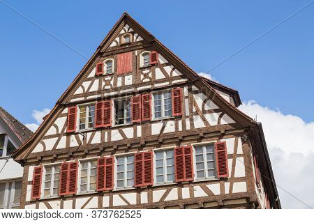 historic half-timbered building made of dark wood with balconies and decorative elements. Tubingen, Baden-Wurttemberg, Germany.