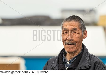 Nuuk, Greenland - August 16, 2019: Portrait Of An Inuit Local Mature Man Looking Camera In Nuuk, Gre