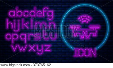 Glowing Neon Smart Drone System Icon Isolated On Brick Wall Background. Quadrocopter With Video And