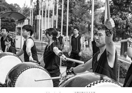 Hiroshima, Japan - September 30, 2019: Male Japanese Drumer Playing Taiko - Kumi-daiko Performance O