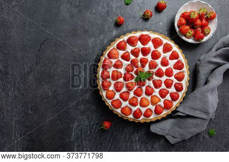 Delicious Strawberry Tart With Whipped Cream And Mascarpone, On A Dark Concrete Background. Top View