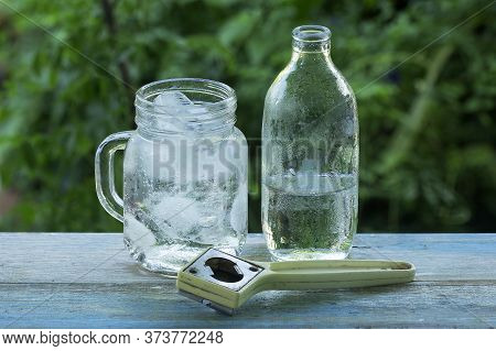 A Glass Of Refreshing Ice Cube And Bottle Soda Water