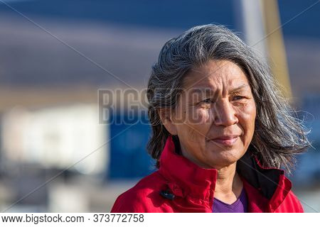 Clyde River, Baffin Island, Canada - August 20th, 2019: Portrait Of A Local Inuit Woman Outdoors In