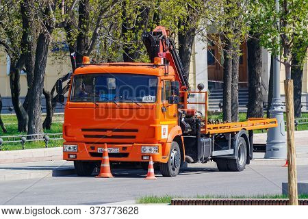 Moscow, Russia - May 01, 2019: Municipal Orange Tow Truck Parked On Moscow Street In Sunny Spring Da