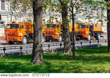 Moscow, Russia - May 01, 2019: Three Large Orange Sprinkler Trucks With Plastic Water Tanks Parked O