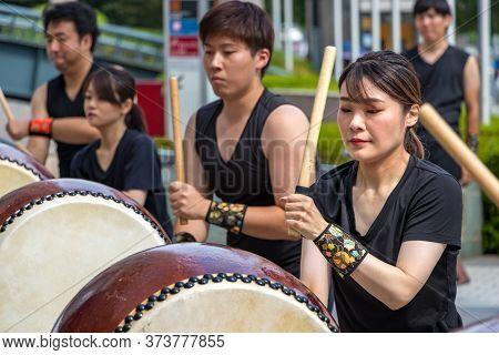 Hiroshima, Japan - September 30, 2019: Female Japanese Drumer Playing Taiko - Kumi-daiko Performance