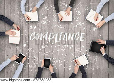 Group of business people working in office with COMPLIANCE inscription, coworking concept