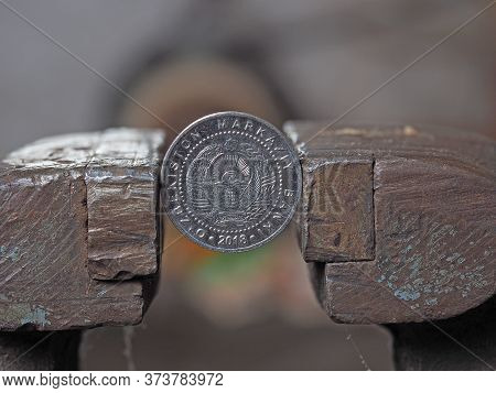 Uzbek Coin Som Clamped In A Metal Vise. Currency And Uzbekistan Economy Under The Onslaught, The Con