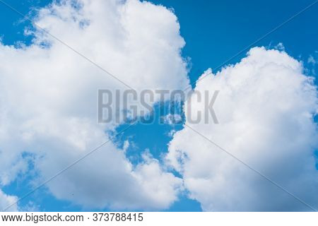 Blue Sky And White Cumulus Clouds. Clear Clear Sky, Good Weather.
