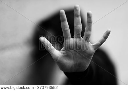 Hand Of The Little Girl Who Wants To Protect Herself From Her Attacker During An Abuse With Black An