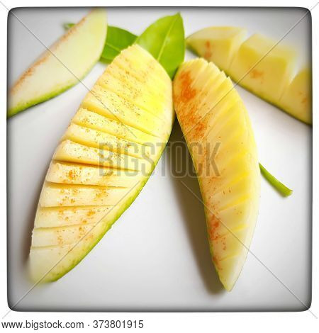 Pieces Of Mango Cut Beautifully Like Slant And Box Slices Arranged In White Plate With Its Leaf Nd S