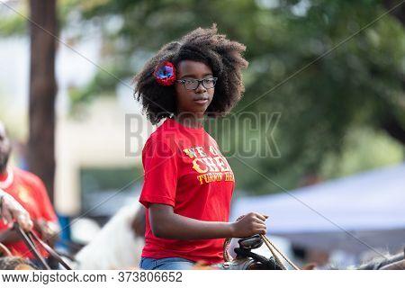 Arlington, Texas, Usa - July 4, 2019: Arlington 4th Of July Parade, Young Woman Riding A Horse Down
