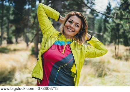 Smile Girl Exercising Outdoors. Relaxing Activity With Stretch Arms. Young Fit Woman Doing Stretchin