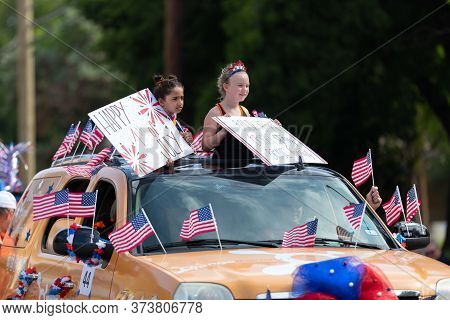 Arlington, Texas, Usa - July 4, 2019: Arlington 4th Of July Parade, Girls On A Car With Flags, Holdi