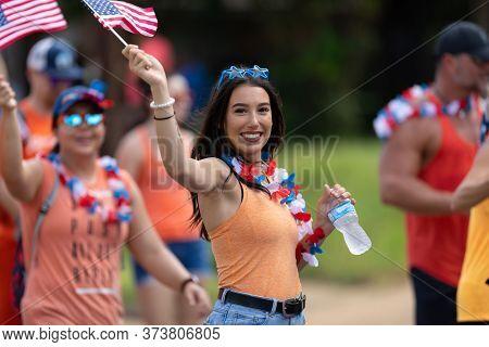 Arlington, Texas, Usa - July 4, 2019: Arlington 4th Of July Parade, Woman Waving The American Flag S