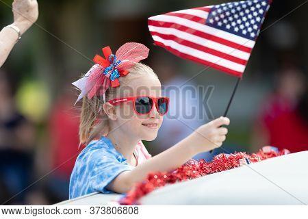 Arlington, Texas, Usa - July 4, 2019: Arlington 4th Of July Parade, Child On A Float Waving The Amer