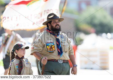 Arlington, Texas, Usa - July 4, 2019: Arlington 4th Of July Parade, Man And Girlf Members Of The Boy