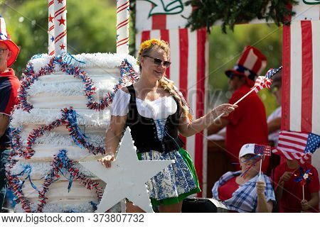 Arlington, Texas, Usa - July 4, 2019: Arlington 4th Of July Parade, Woman On Float Wearing German St