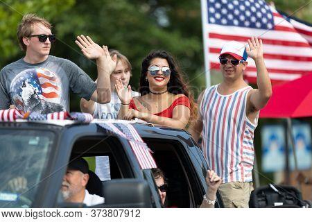 Arlington, Texas, Usa - July 4, 2019: Arlington 4th Of July Parade, People Riding On The Back Of A T