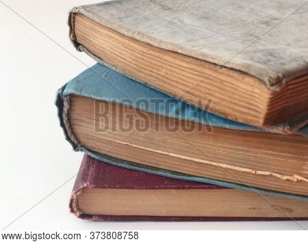 Stack Of Hardcovered Books On White With Copy Space