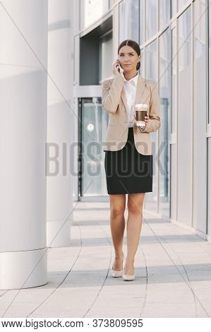 Beautiful Professional Business Woman Call Mobile Phone And Drink Coffee On Lunch Break Near Office
