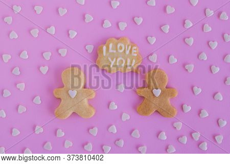 Homemade Shortbread Cookies Decorated White Glaze. Two People With Callout Cloud With Text 'i Love Y