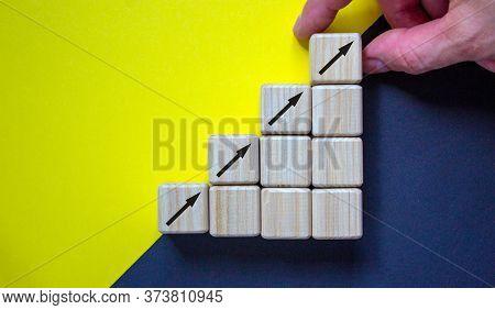Business Concept Growth Success Process. Close Up Man Hand Arranging Wood Block Stacking As Step Sta