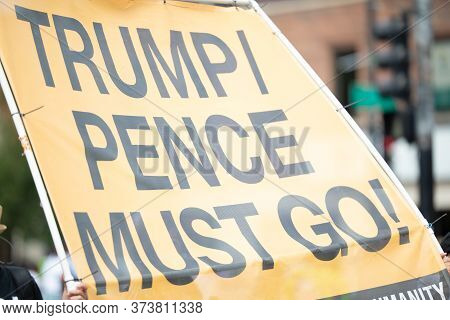 Chicago, Illinois, Usa - August 8, 2019: The Bud Billiken Parade, People Holding A Sign That Says