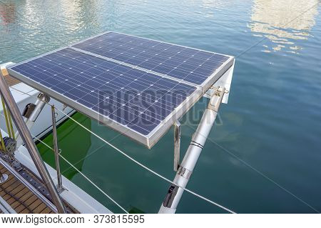 Solar Panel On Sailing Yacht In The Sea. Monocrystalline And Polycrystalline Solar Panels In Yachtin
