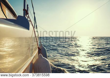 Yacht In The Sea Under Sail At High Speed In A Strong Wind During The Regatta With Sea On The Backgr