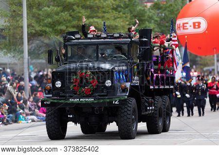 Houston, Texas, Usa - November 28, 2019: H-e-b Thanksgiving Day Parade, An M939 Truck, Of The High W