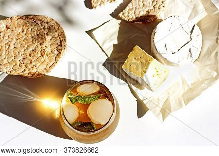 Idea For Summer Breakfast. Iced Summer Drink Cold Tea, Puffed Rise Cakes And Camembert Cheese On A T