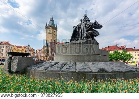 Prague, Czech Republic - May 2019: Jan Hus Memorial And City Hall On Old Town Square (stare Mesto)