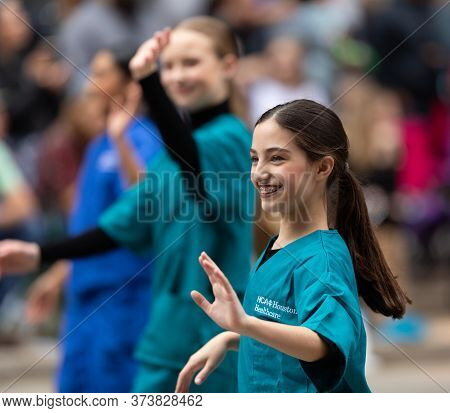 Houston, Texas, Usa - November 28, 2019: H-e-b Thanksgiving Day Parade, Women Promoting Hca Houston