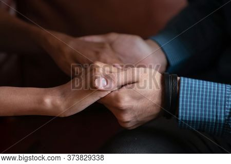 Multi Ethnic Couple In Love Holding Hands Close Up Image