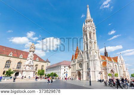 Budapest, Hungary - May 2019: Matthias Church In Fisherman Bastion And Holy Trinity Column