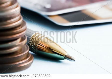 Pen And Calculator On A Financial Graphic. Financing