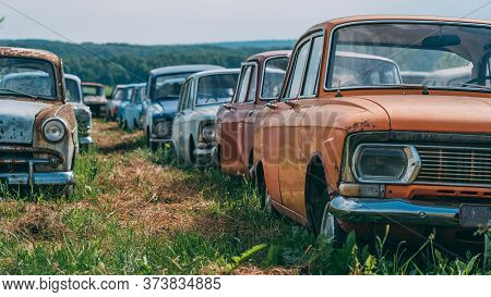 Many Old Abandoned And Forgotten Rusty Vintage Retro Car In Bad Condition, Panoramic View.