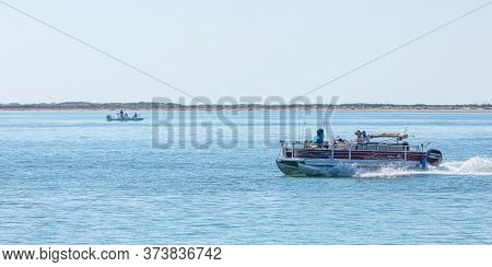 South Padre Island, Texas, Usa - November 19, 2019: Small Fishing Boat Navigating The Brazos Santiag