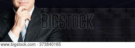 Businessman Face Close Up And Crude Oil Barrel On Black Background. Crude Oil And Petroleum Industry