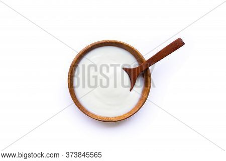 White Yogurt In Wooden Bowl On White Background. Top View