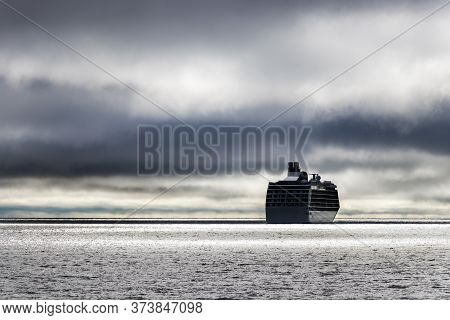 A Cruise Ship At The Bering Sea Entering To A Stormy Weather.
