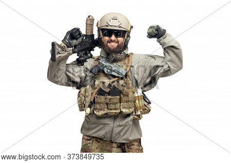 Usa Soldier In A Military Suit With A Rifle Smiles And Shows Strength On A White Background, America