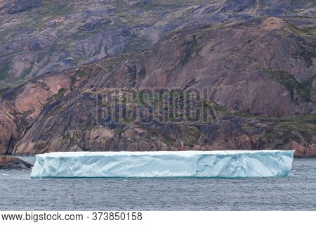 Iceberg At The Skjoldungen Fjord, A Coastal Island In The Southeastern Shores Of Greenland. It Is Lo