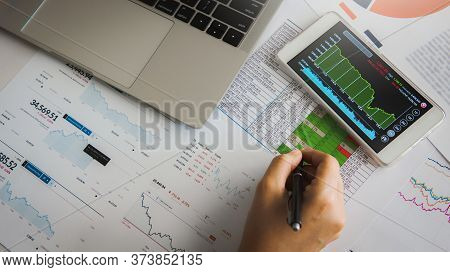 Businesswoman Analyze Business Report Graph And Finance Chart Using Smartphone And Computer Laptop A
