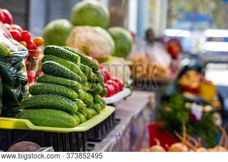 Cucumbers In A Pile On A Tray In A Local Market In Petropavlovsk-kamchatsky, Russia.