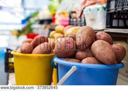 Potatoes On Buckets In A Local Street Market In Petropavlovsk, Russia.